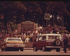 PEOPLE_CONGREGATE_IN_THE_TOWN_SQUARE_IN_COTTONWOOD_FALLS_KANSAS__NEAR_EMPORIA__WAITING_FOR_THE_PARADE_TO_PASS._IT_IS..._-_NARA_-_557057.jpg