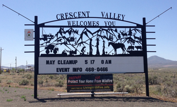 2014-05-31_13_56_25_Sign_at_the_north_entrance_to_Crescent_Valley__Nevada_along_Nevada_State_Route_306-cropped.JPG