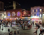 Sixth_Street__Austin__at_night.jpg