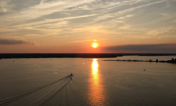 2016-07-20_20_05_12_View_northwest_up_the_Patuxent_River_from_the_Governor_Thomas_Johnson_Bridge__Maryland_State_Route_4__along_the_border_of_Solomons__Calvert_County__Maryland_and_California__St._Mary_s_County__Maryland_just_before_sunset.jpg