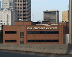 The_Hartford_Courant_building_in_downtown_Hartford__seen_from_I-84_East.jpg