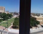 Midland_County_Courthouse__Midland__TX__on_left__looking_north_across_Wall_Street_from_Midland_Hilton.JPG