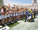 US_Navy_060909-N-3271W-002_The_Brigham_Young_University_Cheer_Squad_greet_the_U.S._Navy_Parachute_Demonstration_Team_Leap_Frogs_after_they_parachuted_into_the_stadium_prior_to_the_game.jpg