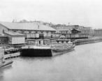 Lumber_Docks_in_Old_Saginaw_City_at_Mackinaw_Street_1888.jpg