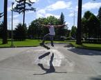 Teen_male_skater_in_Salem_Oregon_park_jump.jpg