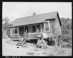Home_of_Negro_miner_who_lives_in_company_housing_project._Adams__Rowe___Norman_Inc.__Porter_Mine__Adamsville..._-_NARA_-_540605.jpg