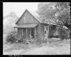 Home_of_Alvis_New__miner__living_in_company_housing_project._Adams__Rowe___Norman_Inc.__Porter_Mine__Adamsville..._-_NARA_-_540592.jpg