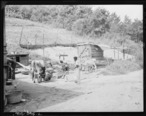 Backyard_of_home_of_Butler_Phillips__miner__who_lives_in_company_housing_project._Adams__Rowe___Norman_Inc.__Porter..._-_NARA_-_540597.jpg