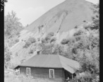 Home_of_Negro_miner_living_in_company_housing_project_with_slag_pole_in_rear._Adams__Rowe___Norman_Inc.__Porter_Mine..._-_NARA_-_540604.jpg