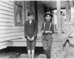 Springstein_Mill._John_Lewis__boy_with_hat___12_years_old__1_year_in_mill._Weaver_-_4_looms._40__cents__a_day_to..._-_NARA_-_523117.jpg