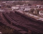 COAL_YARD_WITH_LOADED_RAIL_CARS_READY_TO_BE_SHIPPED_TO_CUSTOMERS_OUT_OF_DANVILLE__WEST_VIRGINIA__NEAR_CHARLESTON._IT..._-_NARA_-_556407.jpg