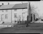 Lancaster__Pennsylvania_-_Housing._Low-priced_houses_on_Cabbage_Hill_-_rental_about__12.00_per_month_-__umbrella..._-_NARA_-_518455.jpg