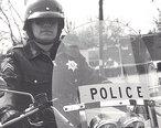 Gatihersburg_Police_Department_motorcycle_officer__1980s.jpg