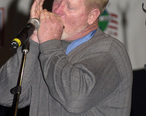 Sammy_Davis_playing_harmonica_2000.jpg