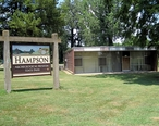 Wilson_AR_Hampson_Museum_State_Park_58_sign_and_museum.jpg
