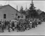 Centerville__California._Members_of_farm_families_await_evacuation_bus._Farmers_and_other_evacuees_._._._-_NARA_-_537574.jpg