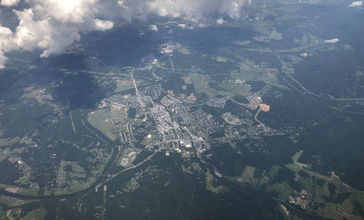 2019-07-19_13_07_10_View_of_Front_Royal__Interstate_66__U.S._Routes_340_and_522_and_Virginia_State_Route_55_in_Warren_County__Virginia__viewed_from_an_airplane_which_recently_took_off_from_Washington_Dulles_International_Airport.jpg