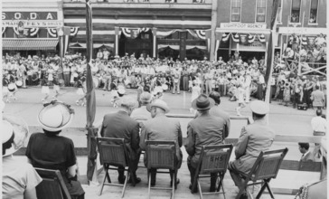 President_Harry_S._Truman_and_other_dignitaries_on_the_reviewing_platform__watching_a_parade__in_Bolivar__Missouri...._-_NARA_-_199906.jpg