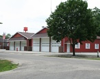 Fisher_Illinois_fire_station_and_water_tower.jpg