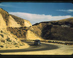 Road_cut_into_the_barren_hills_which_lead_into_Emmett._Emmett__Idaho__July_1941.jpg