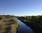 2013-05-31_18_22_04_View_southwest_along_the_Humboldt_River_from_the_9th_Street_Footbridge_in_downtown_Elko_Nevada.jpg