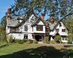 The_Alders__now_Manor_House___a_Victorian_Tudor_mansion_in_Norfolk__Connecticut.jpg