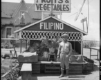 San_Lorenzo__California._Fruit_and_vegetable_stand_on_highway_operated_by_Filipino._This_year_he_._._._-_NARA_-_537768.jpg