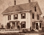 A_house_with_two_porches__Vinalhaven__Me__by_William_V._Lane_crop.jpg