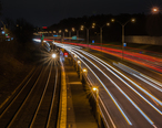 Outbound_train_at_Newtonville_at_night.jpg
