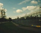 Partial_View_of_Gowanda_Correctional_Facility_with_Power_Plant_in_Background_at_Left__September_1996.jpg