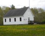 Dry_Mills_Schoolhouse_Museum_in_Spring.JPG