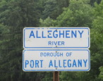 Signs_at_the_bridge_where_Route_155_joins_Route_6__Port_Allegany__PA.jpg