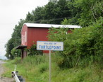 Road_sign_for_Turtlepoint_PA_with_building_in_background.jpg