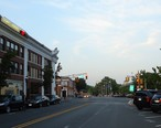 Cranford_NJ_street_and_stores_and_train_station.jpg