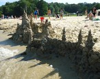 Sandcastle_seen_from_lake_with_people_in_background.jpg