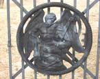 Old_Newton_Burial_Ground_Newton_NJ_detail_of_Father_Time_on_wrought_iron_gate.jpg