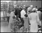 Woodland__California._Farm_families_of_Japanese_ancestry_waiting_at_the_railroad_station_for_the_sp_._._._-_NARA_-_537809.jpg