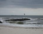Atlantic_Beach_New_York_jetty_with_US_flag.jpg