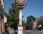 Okanogan__WA_-_street_clock_and_post_office.jpg
