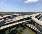2019-07-15_13_34_07_View_south_along_Interstate_395__Cal_Ripken_Way__at_its_junction_with_Interstate_95_from_the_overpass_for_the_ramp_from_Interstate_395_southbound_to_Interstate_95_northbound_in_Baltimore_City__Maryland.jpg