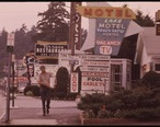 ROW_OF_MOTELS_AT_LAKE_GEORGE_VILLAGE__NEW_YORK__AND_PLETHORA_OF_SIGNS_CREATES_A_NON-RUSTIC_SCENE_IN_THE_ADIRONDACK..._-_NARA_-_554550.jpg