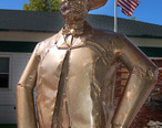 Abner_Weed_statue__Centennial_Plaza__Weed__California.jpg