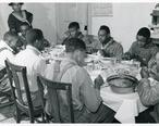 The_Negro_tenants_and_neighbors_eating_dinner_after_the_whit...__3109741227_.jpg