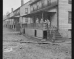 Home_and_family_of_Monzel_Cox_in_company_housing_project._In_foreground_of_picture_is_caked_mud_left_by_flood_of..._-_NARA_-_540284.jpg