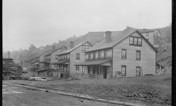 Row_of_houses_in_company_housing_project._This_area_was_flooded_about_June_1__1946__when_storm_sewer__left_center_in..._-_NARA_-_540290.jpg