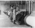 Girls_running_warping_machines_in_Loray_Mill__Gastonia__N.C._Many_boys_and_girls_much_younger._Boss_carefully_avoided..._-_NARA_-_523104.jpg