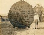Herbert_E._Fuller_standing_next_to_an_Altamonte_Hotel_sign.jpg