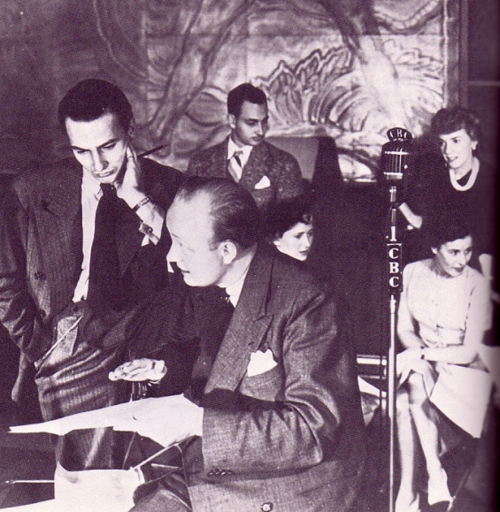 """imagine-p72 - During a drama rehearsal in CBR's studio A, actor-writer Fletcher Markle (left), confers with CBC producer Andrew Allan. In the background are cast members Al Pearce, Claire Murray, Peggy Hazard and Kathy Graham.  The play in production is probably from the series """"Baker's Dozen"""" written by Markle and broadcast in 1941 & 1942."""