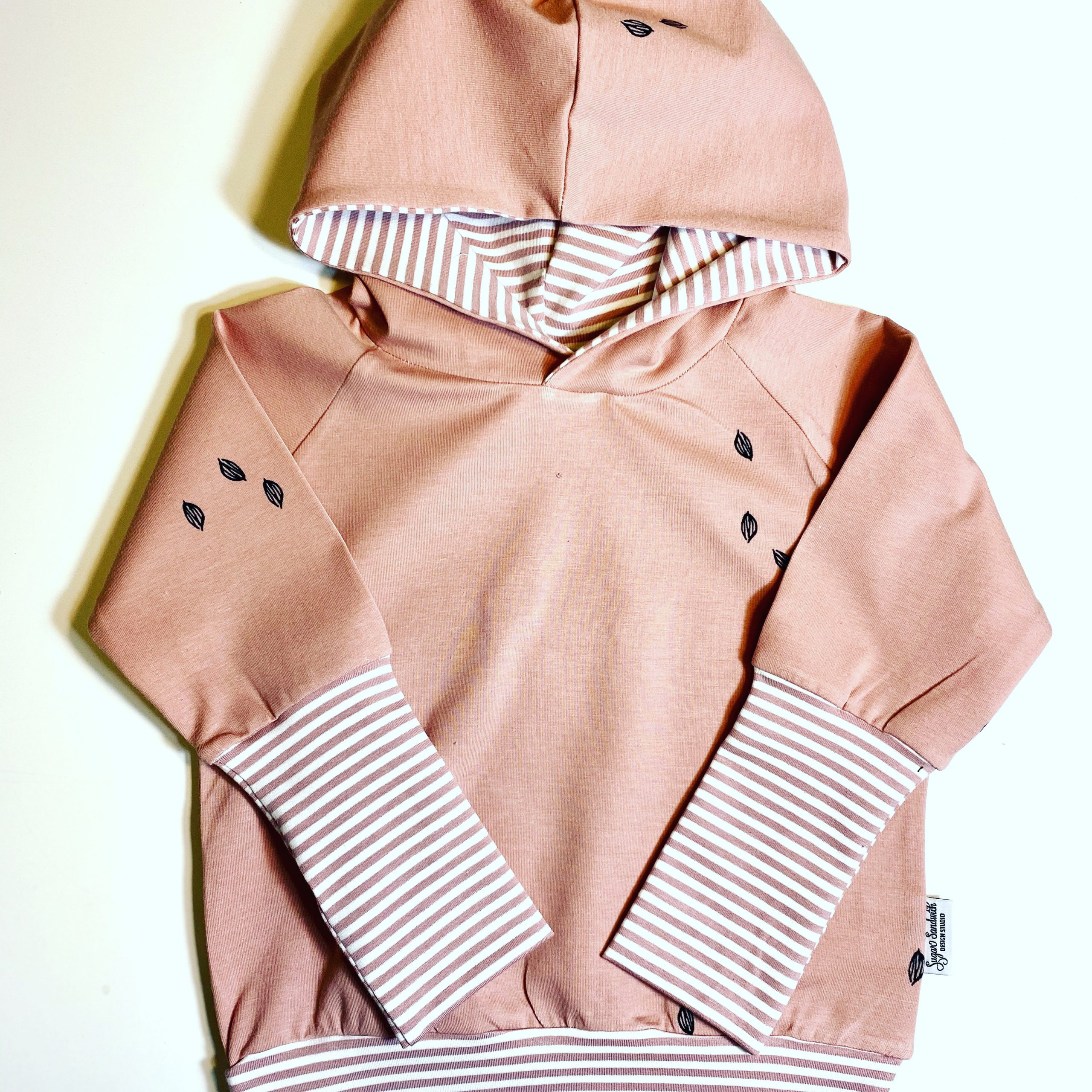 pink hoodie with striped cuff hooded sweater grow along babywear adjustable fit for infants and children