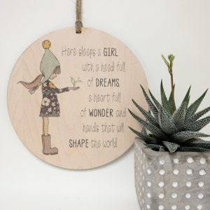 Here sleeps a girl with a head full of dreams, a heart full of wonder and hands that will shape the world! Delightful and inspirational wall hanging for your baby's room or child's room., gift tag, tree ornament, wall banner